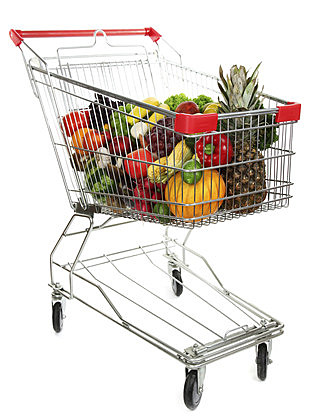 Different fruits and vegetables in trolley isolated on white